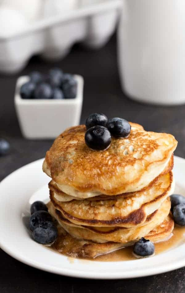 Stack of Blueberry Lemon Ricotta Pancakes topped with blueberries