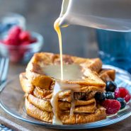 Buttermilk Syrup pouring onto a stack of French toast