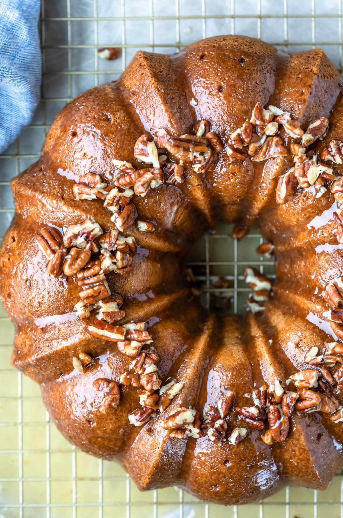 Irish cream bundt cake topped with pecans
