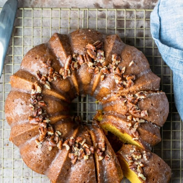 Irish cream bundt cake on a gold wire cooling rack