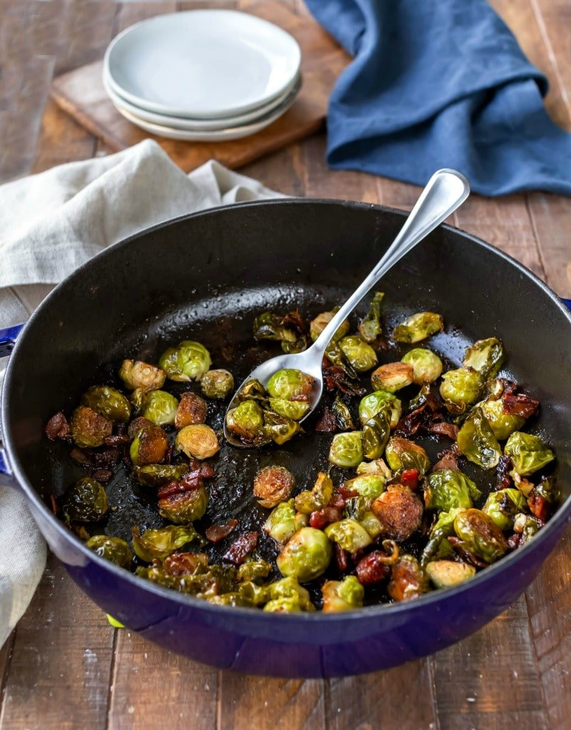 Maple bacon balsamic brussels sprouts in a blue enamel cast iron skillet