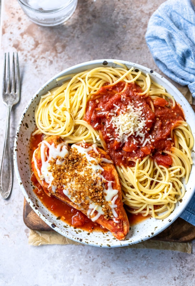 Slow Cooker chicken parmesan on a plate next to a silver fork