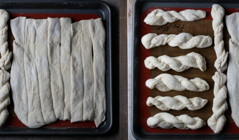 Twisted breadstick dough on a silicone baking mat