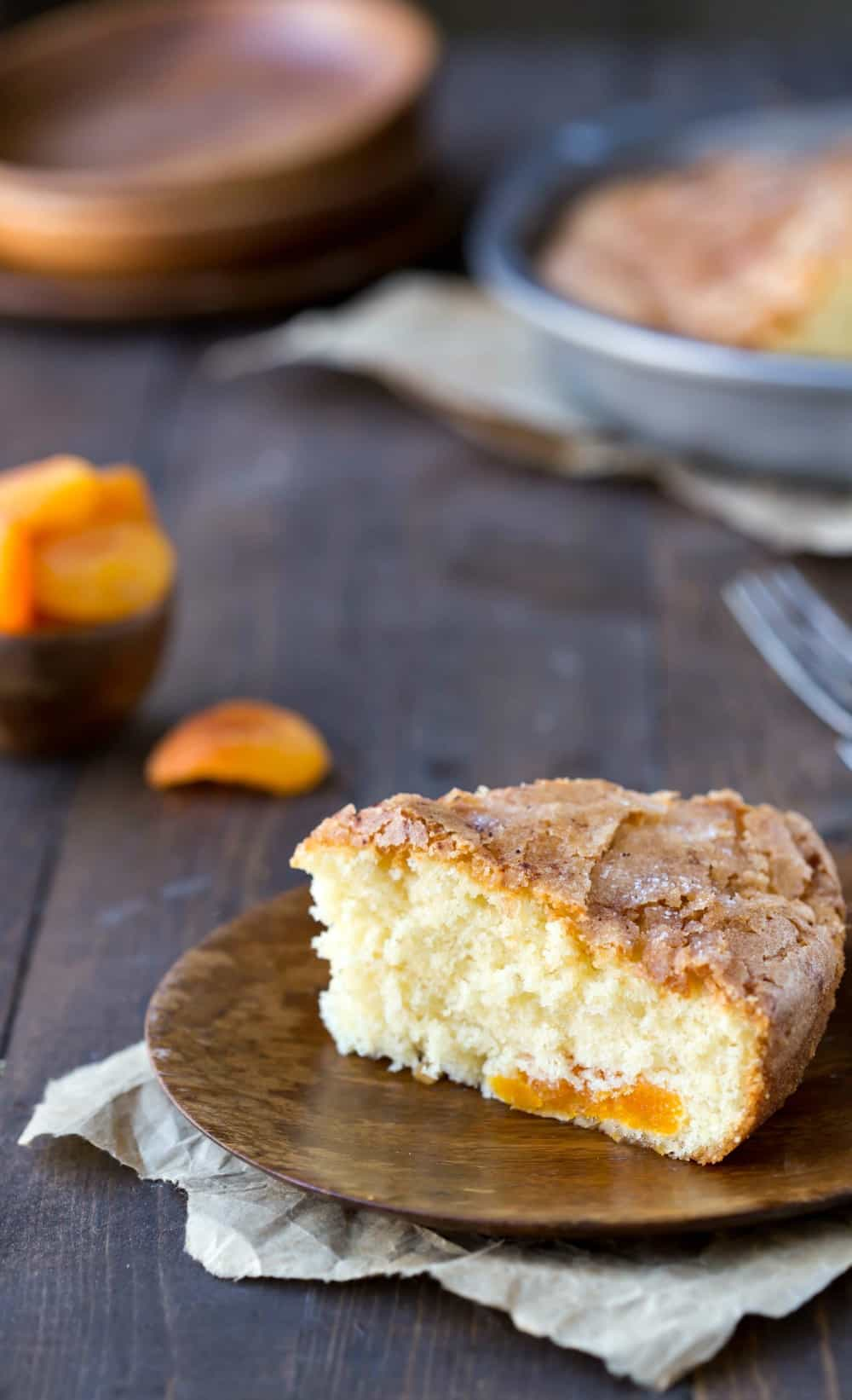 Apricot Kuchen next to a bowl with dried apricots