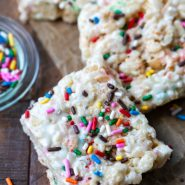 Cake batter rice krispies on a wooden board