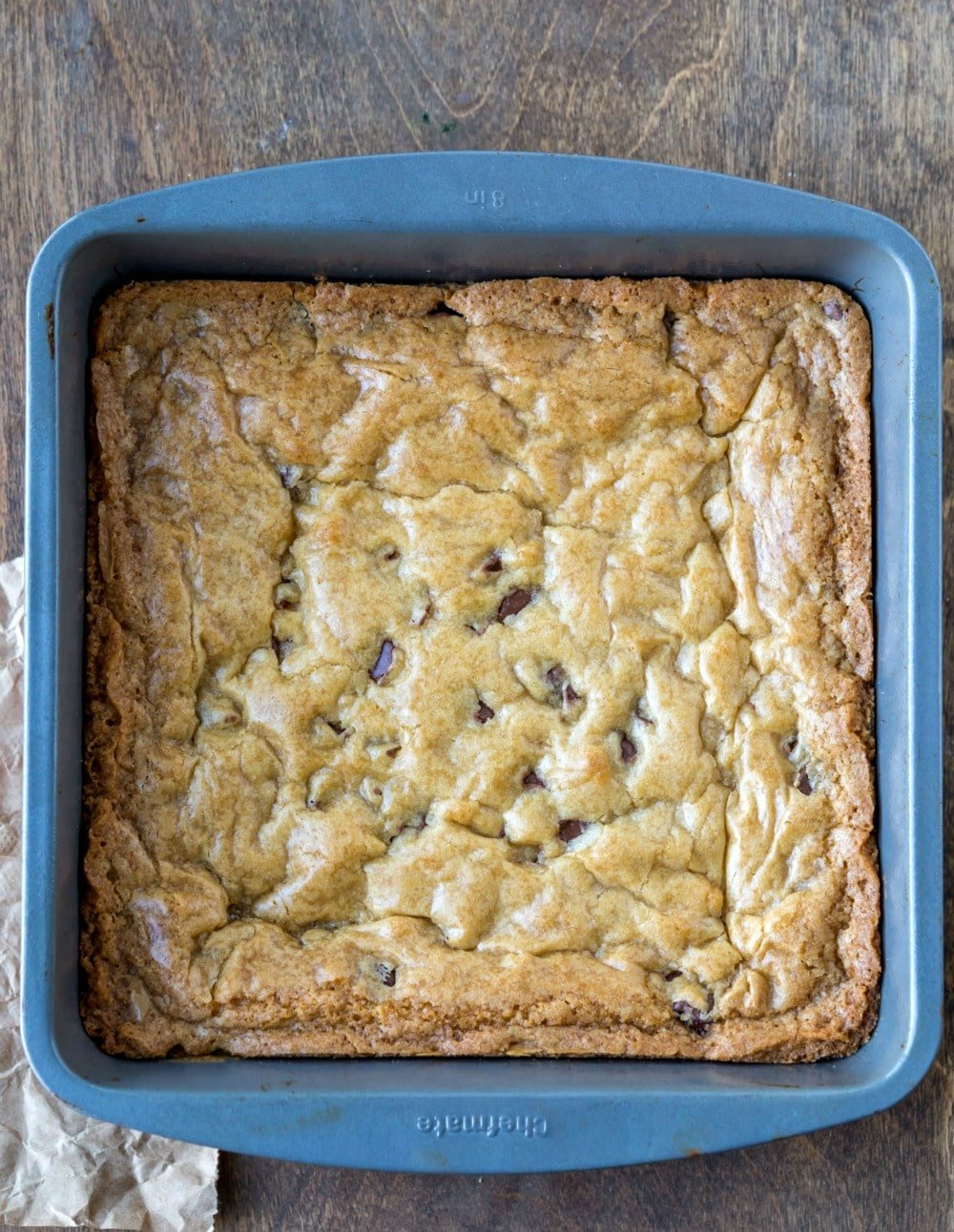 Baked chewy chocolate chip cookie bars in a pan