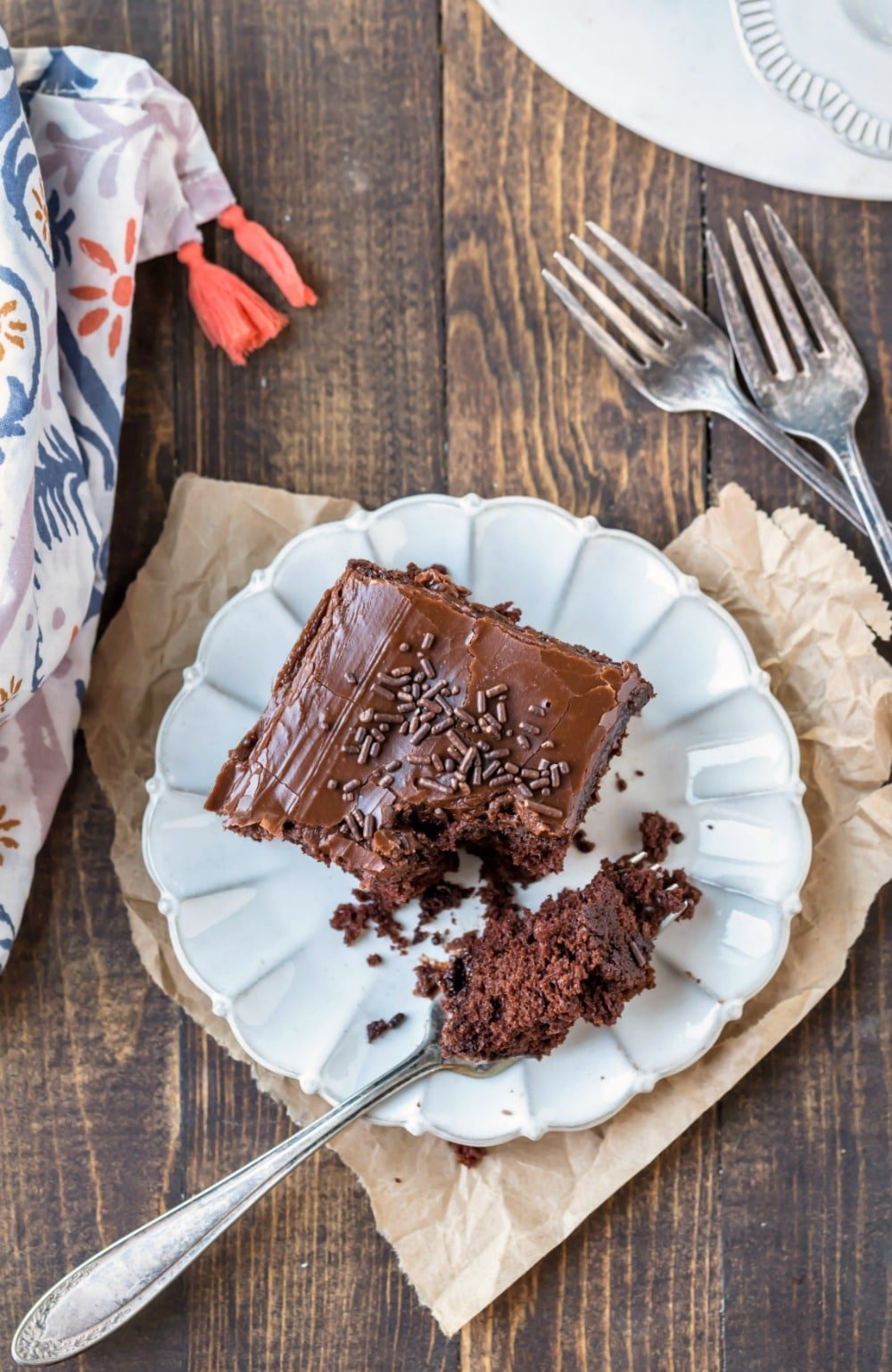 Slice of chocolate mayonnaise cake on a cream plate with a silver fork