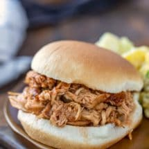 Crock pot bbq chicken on a sandwich bun