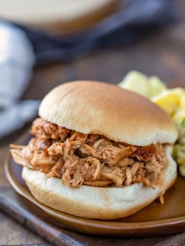 Crock pot bbq chicken on a sandwich bun