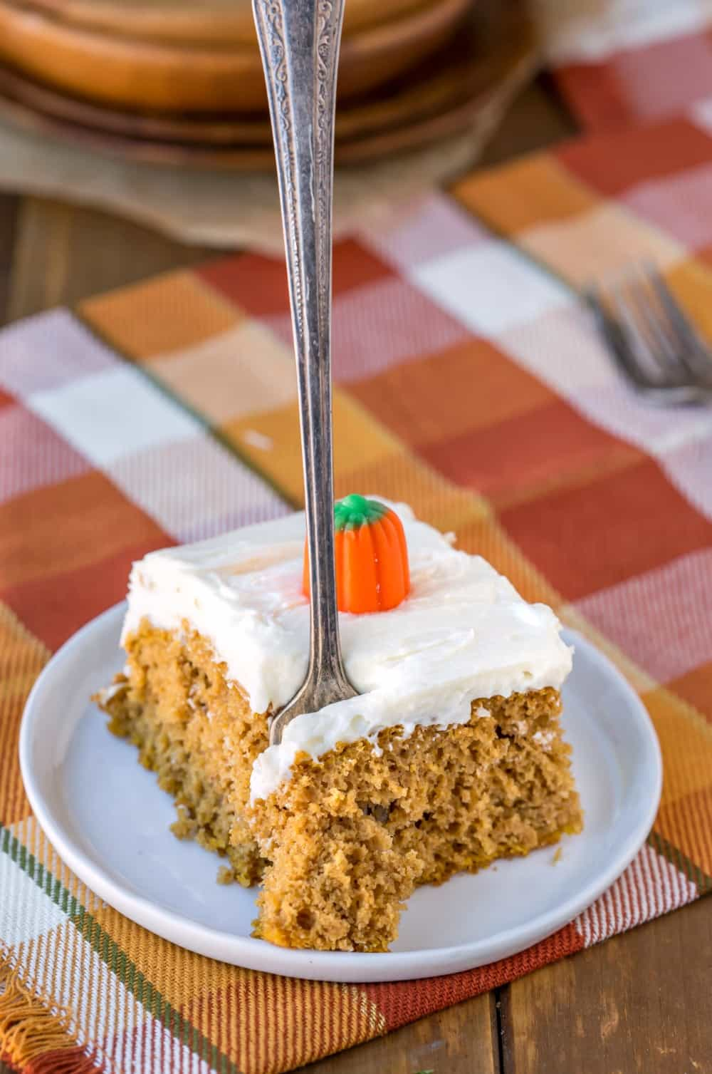 Slice of Pumpkin Spice Cake with a fork taking a bite out of it