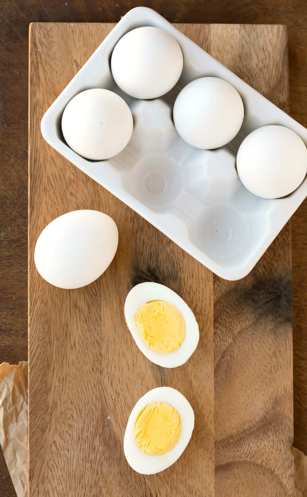 Hard boiled eggs on a wooden cutting board