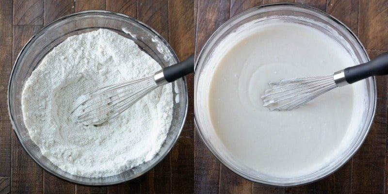 White cupcake batter in a glass mixing bowl
