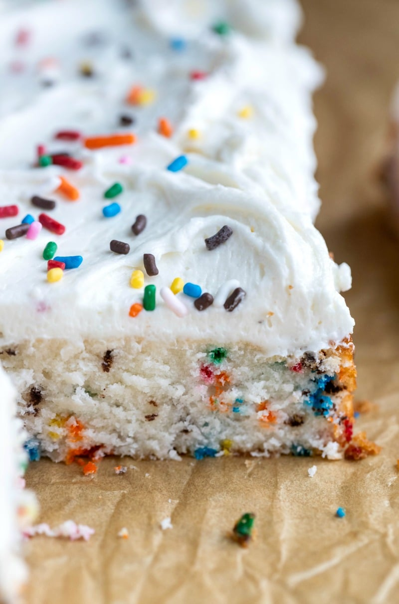 Funfetti Sheet Cake on a piece of brown parchment paper
