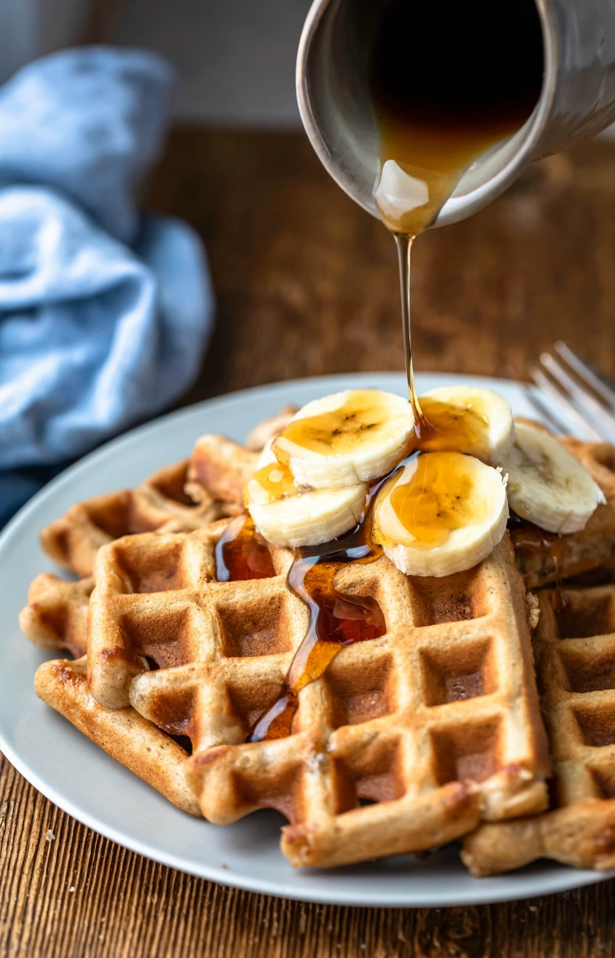 Banana bread waffles with maple syrup on top