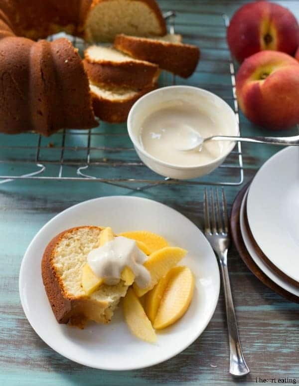 Slice of Greek Yogurt Pound Cake topped with peaches and cream