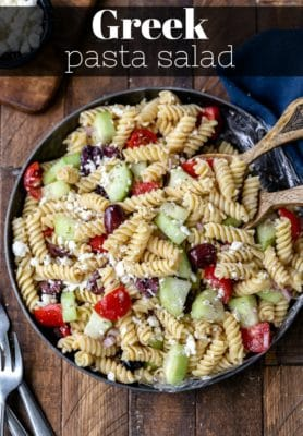 Chopped vegetables and homemade dressing for Greek pasta salad