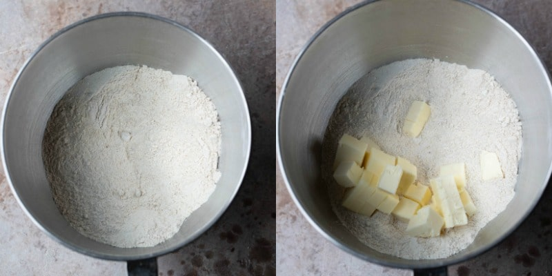 Dry ingredients and cubed butter in a silver mixing bowl