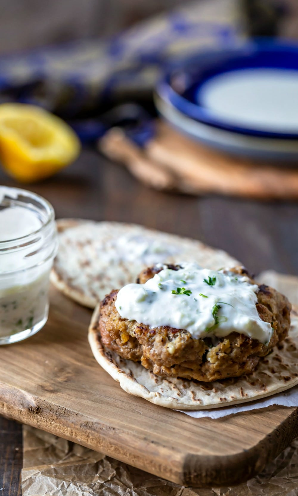 Greek chicken burger topped with tzatziki sauce
