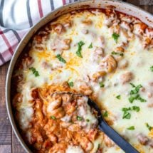 Spoon scooping up easy skillet lasagna from pan
