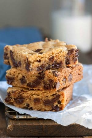 Stack of blondies on a piece of parchment paper
