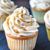 Caramel buttercream frosting topped with caramel sauce and grains of salt.