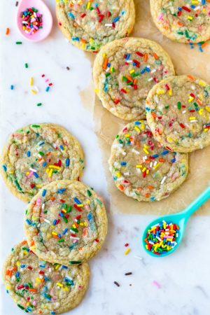 Funfetti cookies and sprinkles on a marble background