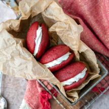 Red velvet whoopie pies in a metal tin