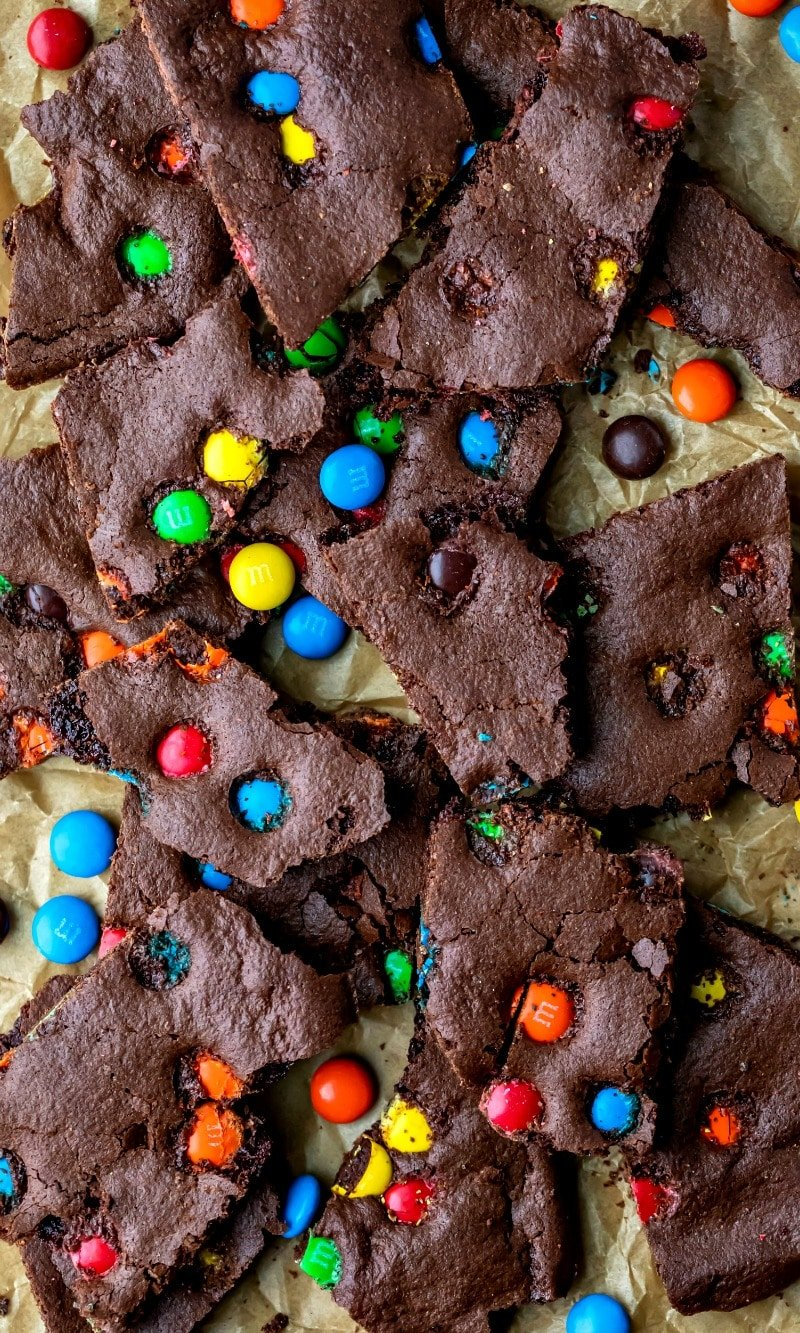M&M brownie bark on a piece of parchment paper