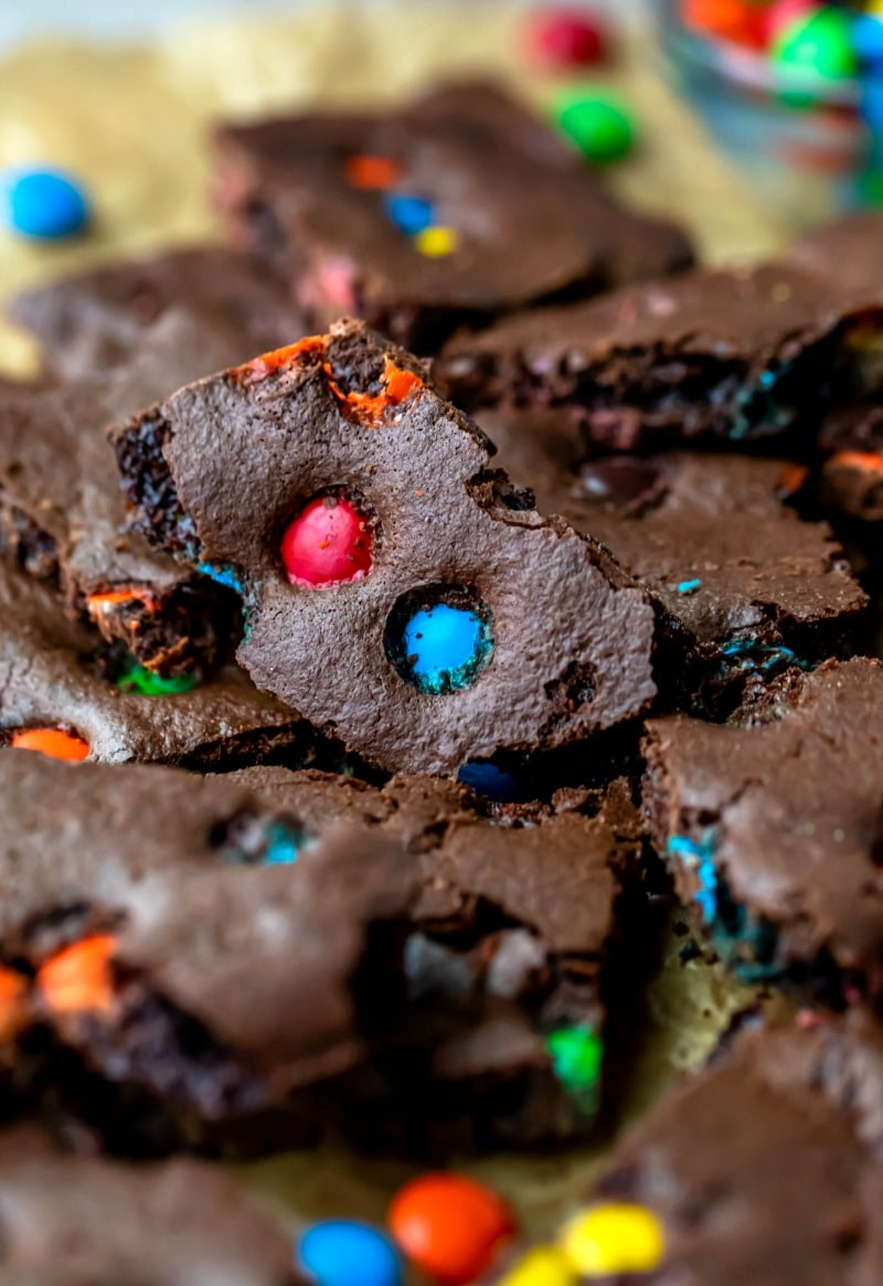 Piece of M&M brownie bark with red and blue M&Ms