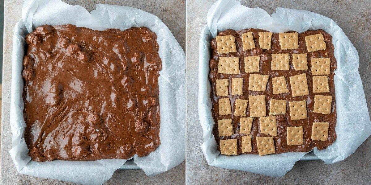 Metal baking pan lined with parchment paper and filled with s'mores fudge