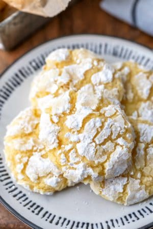 Lemon coconut cookies on a black and whit plate