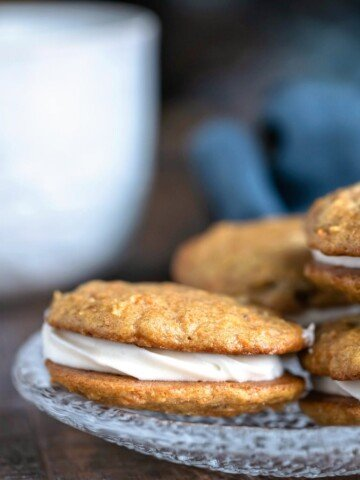 Carrot Cake Sandwich Cookies on a glass plate