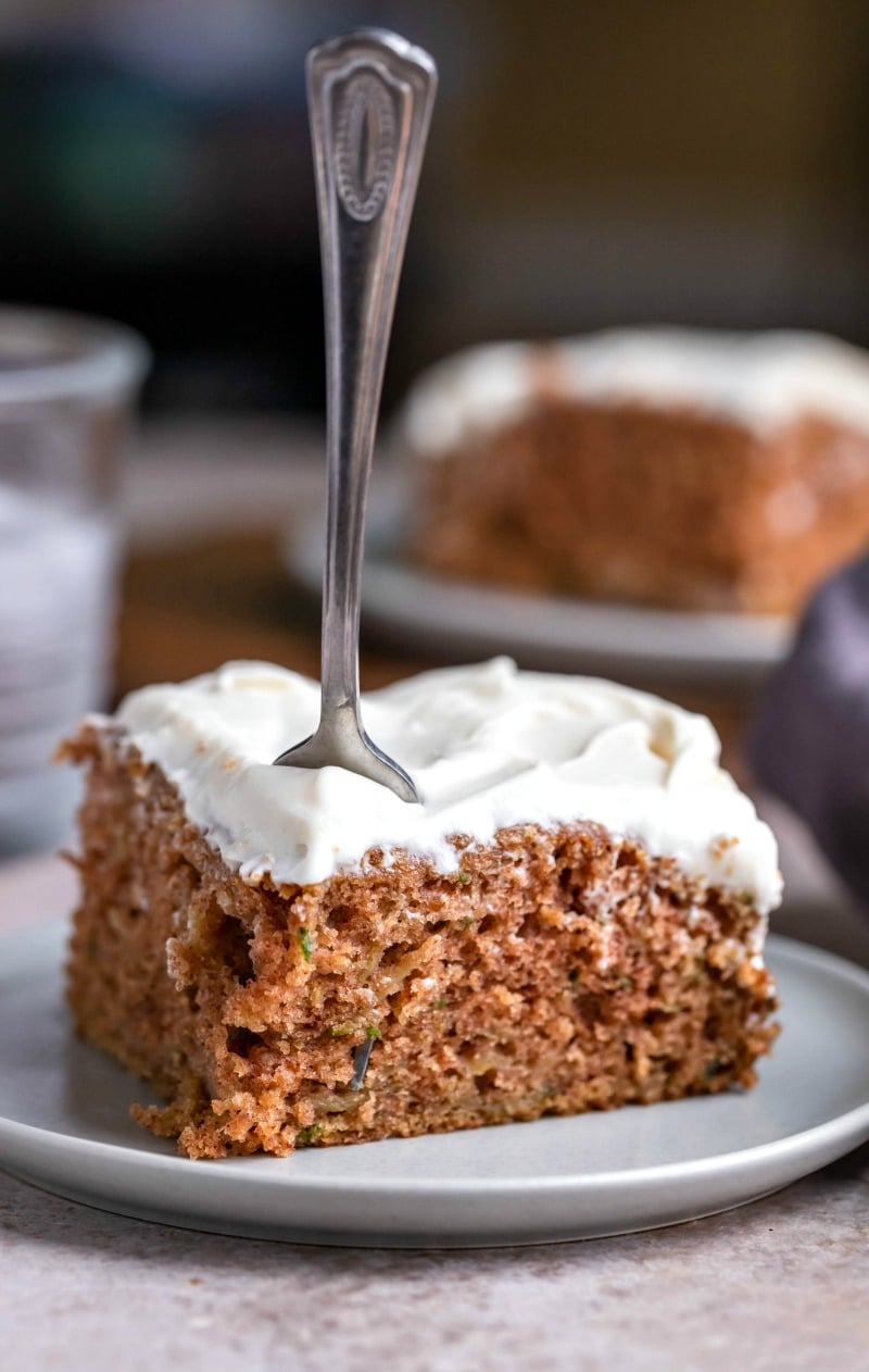 Slice of zucchini cake with a fork stuck in it