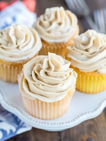 Whipped brown sugar buttercream frosting on a vanilla cupcake