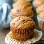Pumpkin chocolate chip muffin with the muffin liner peeled down