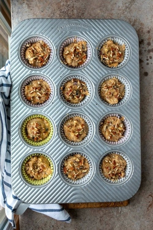 Oatmeal raisin bran muffin batter in a muffin tin