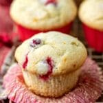Cranberry orange muffin with the cupcake liner peeled down