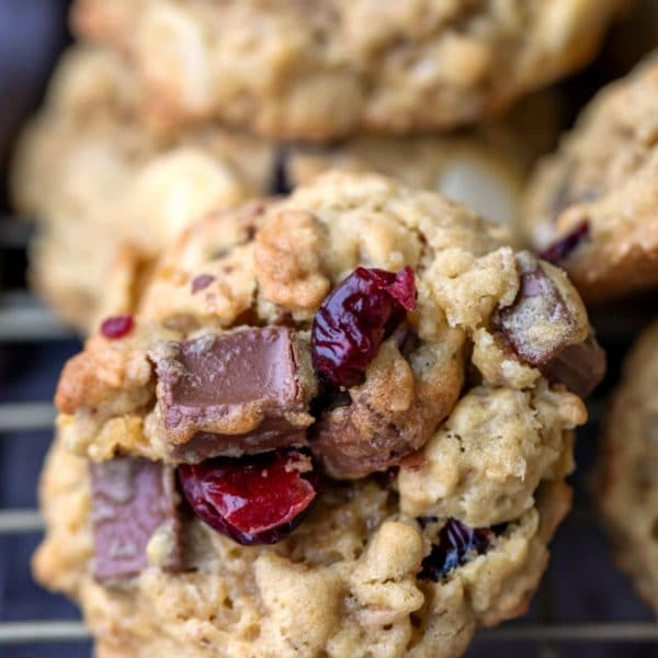 Cranberry oatmeal cookie on a gold wire cooling rack