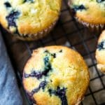 Lemon blueberry muffins next to a blue linen napkin