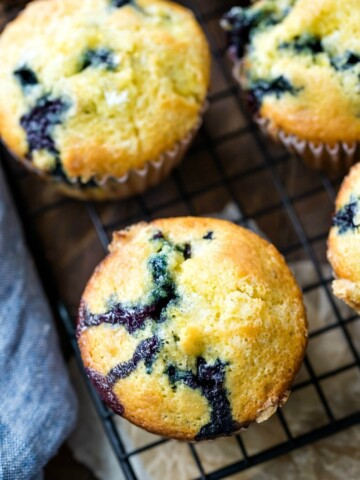 Lemon blueberry muffins next to a blue linen napkin