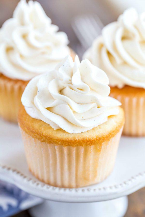 Vanilla bean buttercream frosting on a vanilla cupcake
