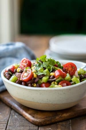 Speckled cream bowl full of black bean salad