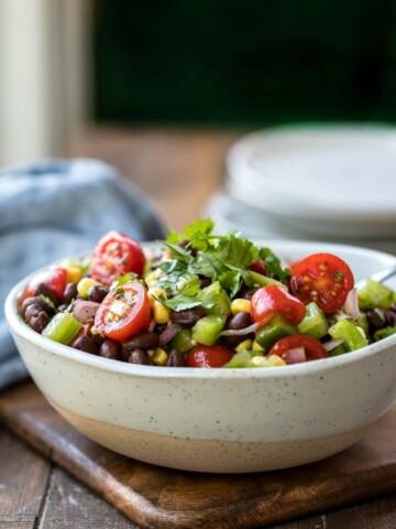 Speckled cream bowl full of black bean salad