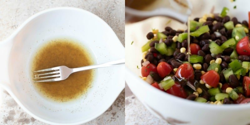 Homemade dressing pouring onto black bean salad