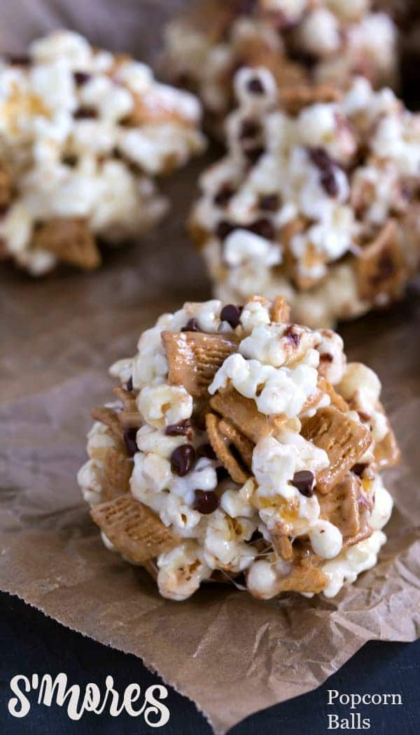S'mores Popcorn Balls on brown parchment paper