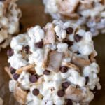 S'mores popcorn balls on a piece of brown parchment paper