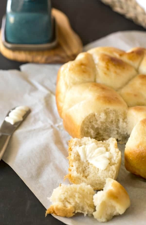 Slow Cooker Dinner Rolls on a piece of white parchment paper