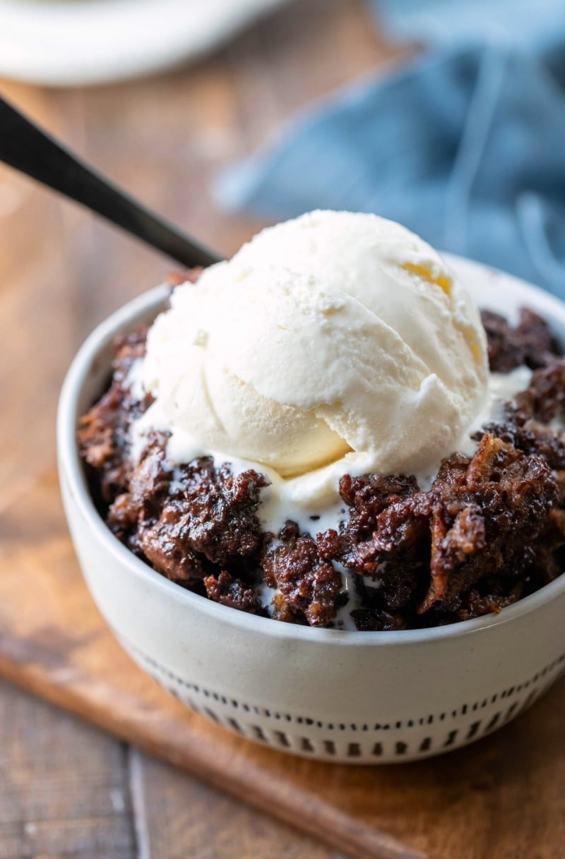 Bowl of Crock Pot Triple Chocolate Bread Pudding topped with vanilla ice cream
