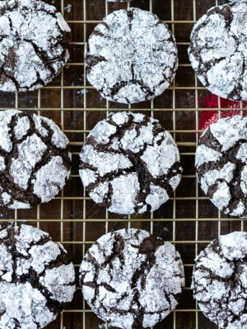 Chocolate Crinkle Cookies on a gold wire cooling rack