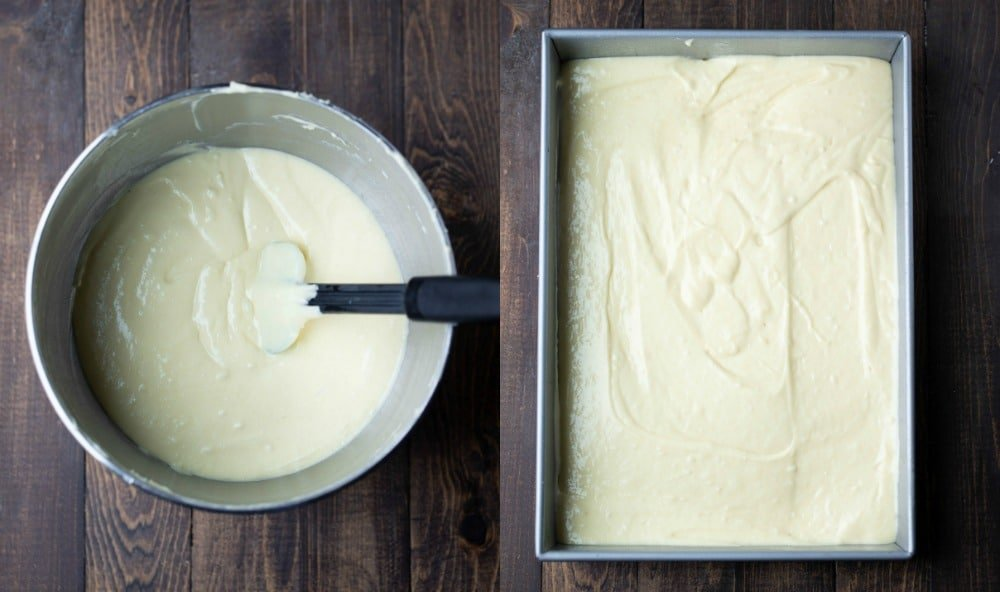 White cake batter in a silver mixing bowl